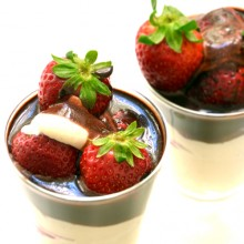 Strawberries with vegetal cream and raw vegan chocolate sauce